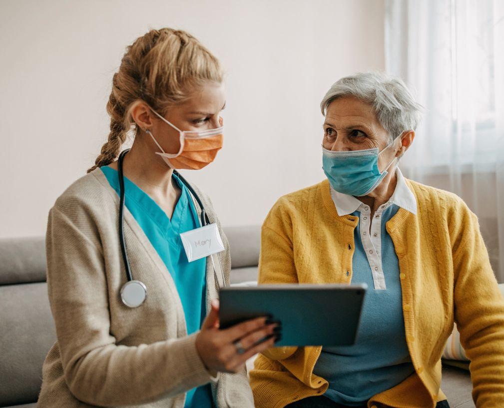 senior nurse helping patient
